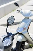 image of speedo  - Two motorbikes parked in street one of them in focus another out of focus - JPG