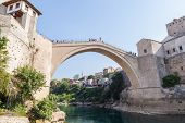 MOSTAR, BOSNIA - AUGUST 10: Man ready to jump from old bridge on August 10, 2012 in Mostar, Bosnia.