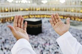image of kaaba  - Muslim Arabic man praying at Kaaba in Mecca - JPG