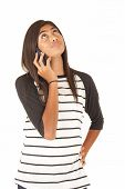 Attractive Young Polynesian Girl Talking On Cell Phone Looking Up