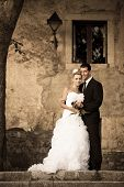 Retro Portrait Of Bride And Groom On A Street