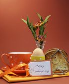 stock photo of heartfelt  - Happy Thanksgiving breakfast for your special one with toast and egg with coffee or tea in an orange polka dot cup and saucer with heartfelt gift tag - JPG