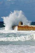 Big white water wave splash, Portreath pier, Cornwall England.