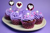 stock photo of bridal shower  - purple decorated cupcakes for children or teens birthday or bridal or baby shower party function - JPG