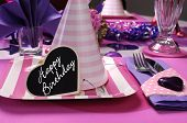 Pink And Purple Theme Party Table Setting Decorations With Party Hat Closeup And Happy Birthday Hear