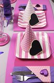 Pink And Purple Theme Party Table Setting Decorations. Vertical With Party Hats And Pink Strip Plate