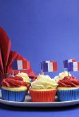 French Theme Red, White And Blue Mini Cupcake Cakes With Flags Of France And Fleur-de-lis Red Napkin