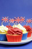 English Theme Red, White And Blue Cupcakes With Great Britain Union Jack Flags For National Party Ce