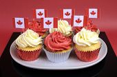 Red And White Cupcakes With Canadian Maple Leaf National Flags Against A Red Background For Canada D