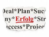 Business concept: Erfolg(german) on Paper background