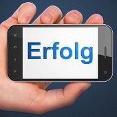 Business concept: Erfolg(german) on smartphone