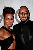 NEW YORK-SEP 28: Recording artist Alicia Keys and husband Swizz Beatz attend the grand opening of TA