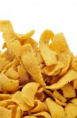 a pile of corn chips on a white background