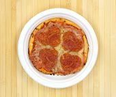 Small Pepperoni Pizza On A Paper Plate