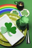 St Patrick's Day Party Table Setting Decorated With Green Polka Dot Plates, Shamrocks, Pot Of Gold A