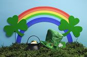 St Patrick's Day Still Life With Leprechaun Hat, Pot Of Gold, Shamrocks And Rainbow On Blue Backgrou
