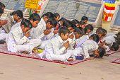 Young Children Pray In Tibetan Buddhist Monastery Sarnath