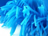 Part of a blue latex toy