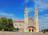 The Jeronimos monastery on the bank of the River Tagus in Lisbon. Two slender towers topped by cross