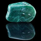 picture of jade  - Jade  mineral stone close up with reflection on black surface background  - JPG
