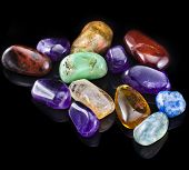 Collection of colorful semiprecious minerals stones on black  background