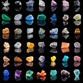 Collection set of semi-precious gemstones stones and minerals with reflection on black  background