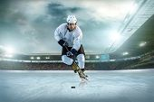 stock photo of skate  - Ice hockey player on the ice - JPG