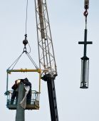 Workers installing a cell phone Antenna on Church Steeple