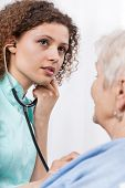 Nurse Examining Elderly Lady