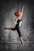foto of  dancer  - young beautiful dancer posing on studio background - JPG