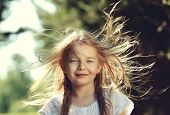 pic of hair blowing  - Hair of pretty little girl hair is blowing in the wind - JPG