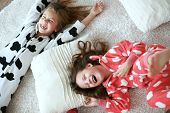 stock photo of preteen  - Children in soft warm pajamas playing at home - JPG