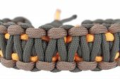 stock photo of paracord  - Tricolor paracord bracelet with clipping paths on white background - JPG