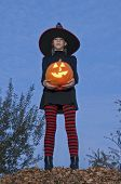 Halloween Pumpkin With Witch Standing