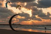 Kite Surfing In The Sunset At The Beach Of Scheveningen, The Netherlands