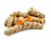 Turmeric roots. Heap of turmeric rhizomes isolated on white background