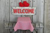 Wood welcome sign by picnic table