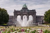 The Triumphal Arch In Cinquantenaire Parc In Brussels, Belgium With Flowers