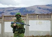 Russian Soldier Guarding An Ukrainian Naval Base In Perevalne, Crimea