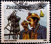ZIMBABWE - CIRCA 1995: A stamp printed in Zimbabwe shows mine workers circa 1995