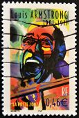 FRANCE - CIRCA 2002: A stamp printed in France shows the famous musician Louis Armstrong circa 2002