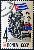 USSR - CIRCA 1963: A stamp printed in Russia shows Soldiers on horseback and Cuban flag