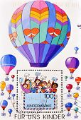 GERMANY - CIRCA 2002: A stamp printed in Germany shows picture of children with cards and balloons