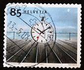 SWITZERLAND - CIRCA 2003: A stamp printed in Switzerland shows image of a stop watch circa 2003
