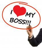 businessman hand with felt tip marker writing text I love my boss with heart shape
