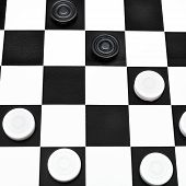 image of draught-board  - playing position on black and white checked draughts board - JPG