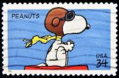 A stamp printed in the United States of America shows image celebrating the cartoon character Peanut