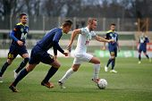 KAPOSVAR, HUNGARY - MARCH 16, 2014: Unidentified players in action at a Hungarian Championship socce