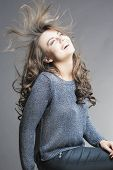 Hair Concepts: Portrait Of Nice And Happy Brunette Woman With Flyaways Hair