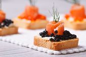 Canapes With Black Sturgeon Caviar, Salmon And Dill. Macro.